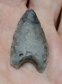 "A scarce, good sized, excellent and finely worked Neolithic ""Hollow Base"" flint arrowhead, found North Yorkshire, 1975. SOLD"